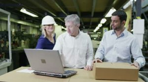 stock-footage-a-team-of-workers-in-a-warehouse-or-factory-are-going-about-their-business-and-preparing-goods-for